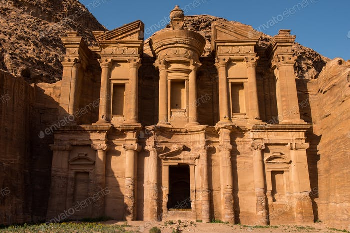 Facade of the Monastery in sunset lights. Petra, Jordan