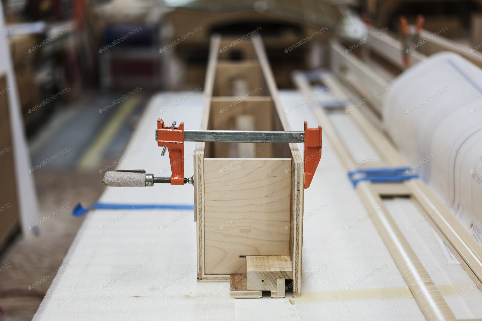 Close Up Of Small Bar Clamps Being Used In A Woodworking Factory Photo By Mint Images On Envato Elements