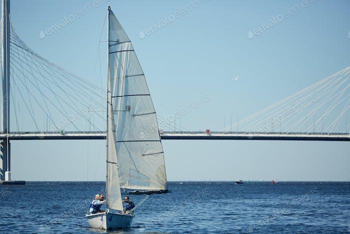 Travelers enjoying sailing on river