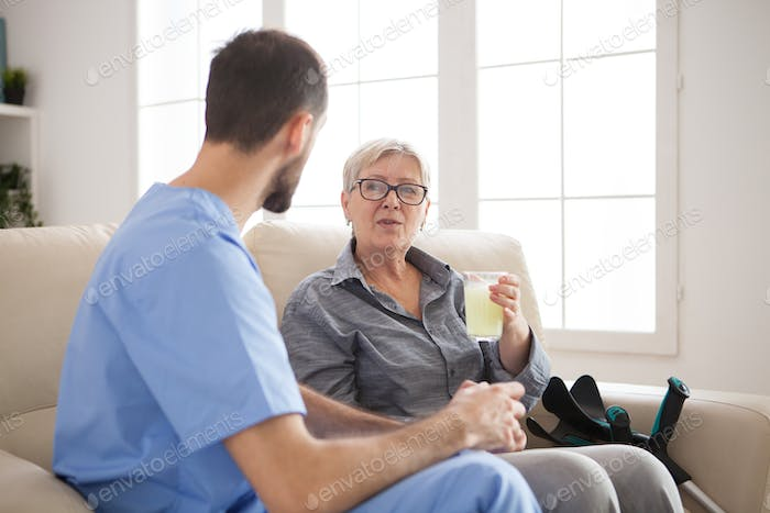 Doctor sitting on couch in nursing home