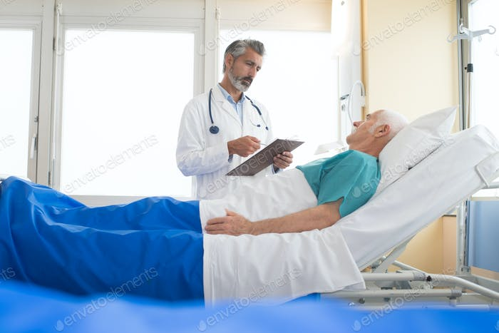 doctor visiting his senior patient at hospital