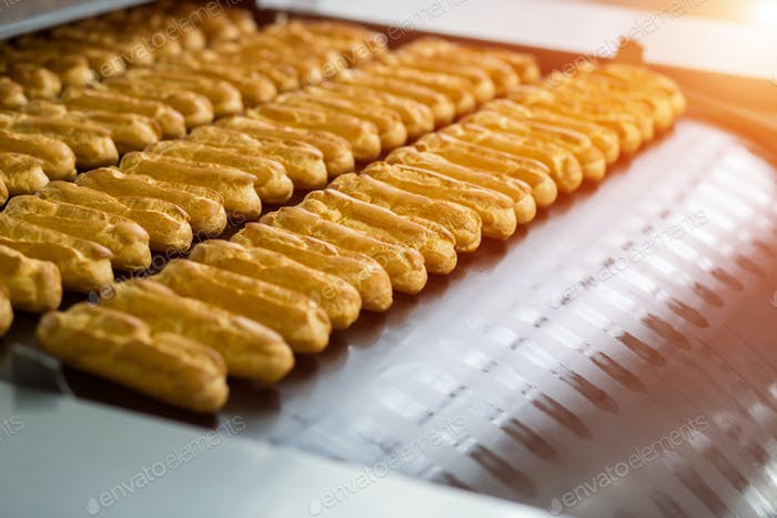 Eclair shells on conveyor line.