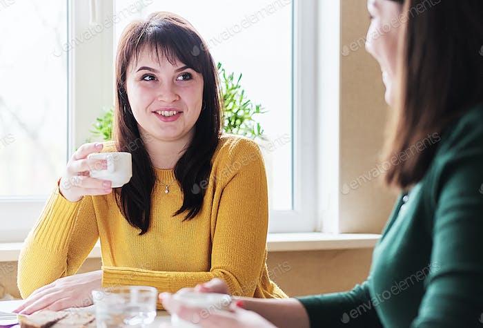 Girlfriends drink coffee
