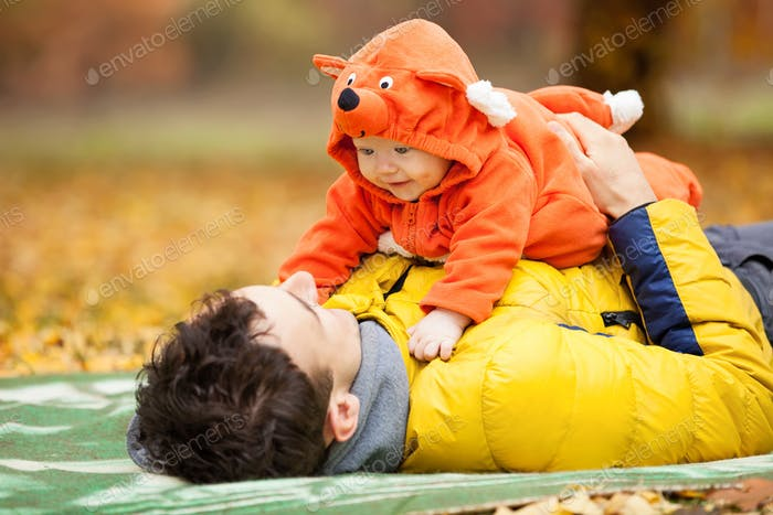 Father and his son in fox costume