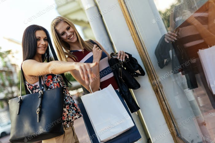 Beautiful women shopping outdoors