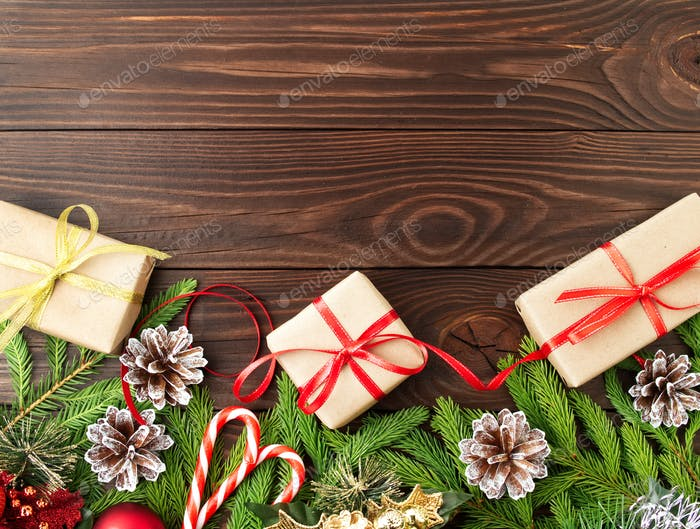 Christmas and Happy New Year dark brown background. Gift Christmas box, fir branches