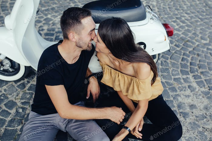 Cute couple with scooter