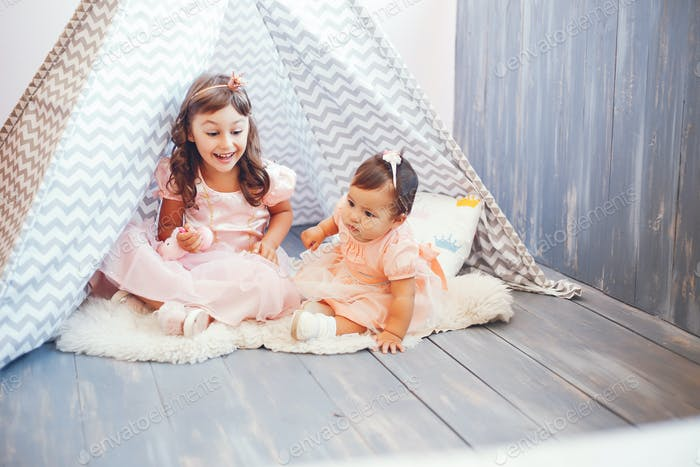 Sisters play in a tent