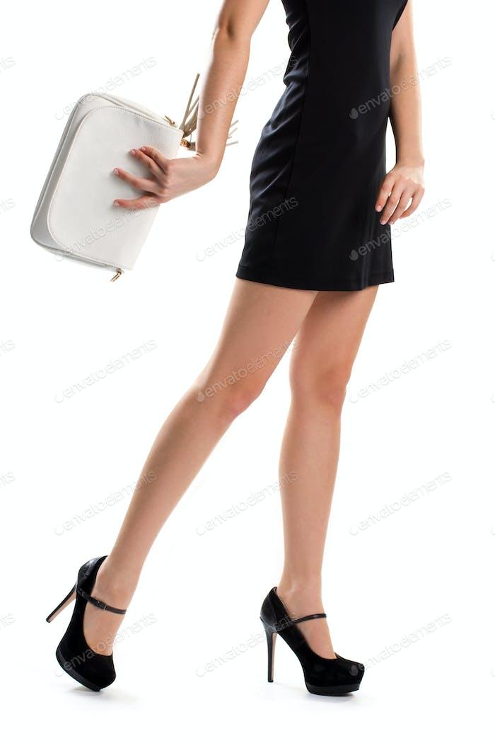 Woman's legs in black heels