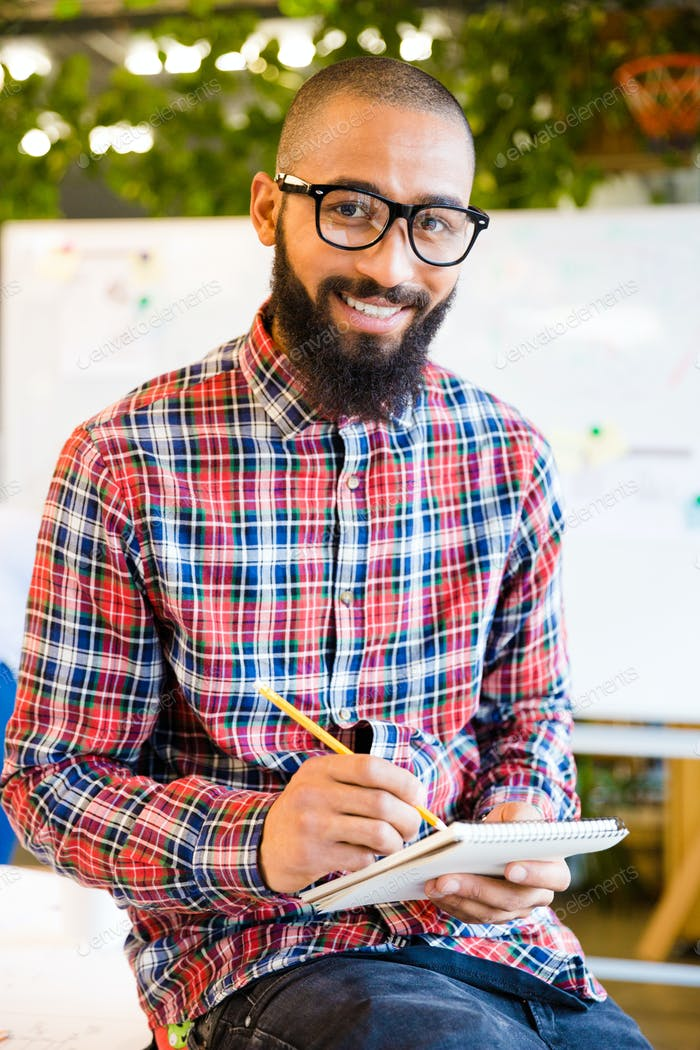 Man sitting on the table with notepad and pencil
