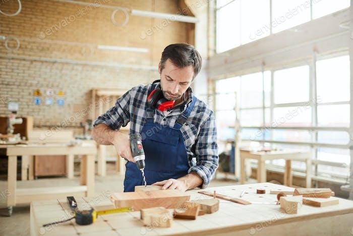 Skilled Carpenter in Workshop