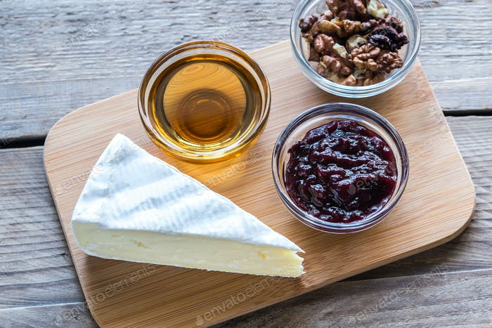 Brie cheese with honey, jam and nuts