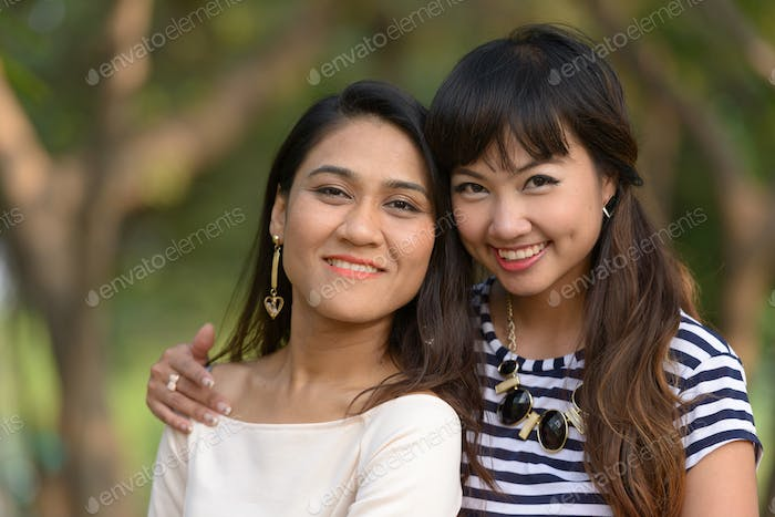 Portrait of two young Asian women together at the park
