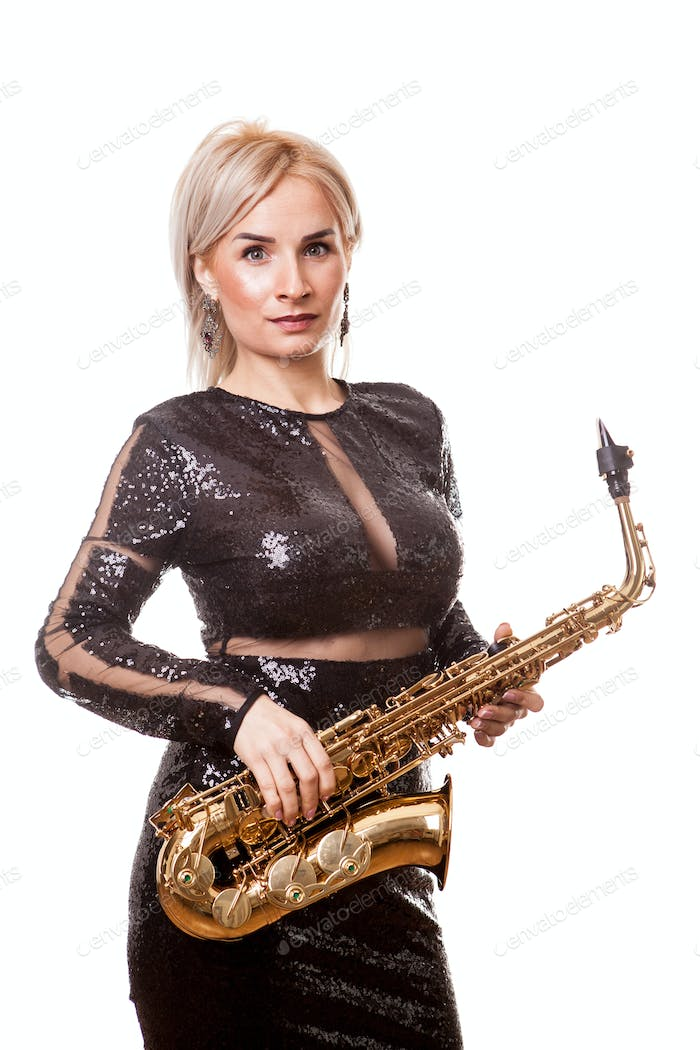 Attractive saxophonist woman playing at her musical instrument