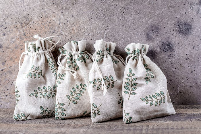 Holiday eco friendly textile gift pouches packaging. Zero waste present bags