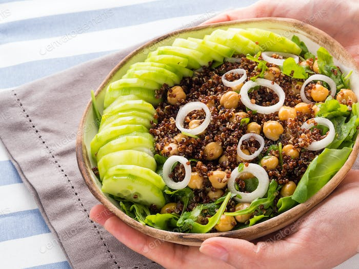 Quinoa salad bowl with cucumbers, chickpeas