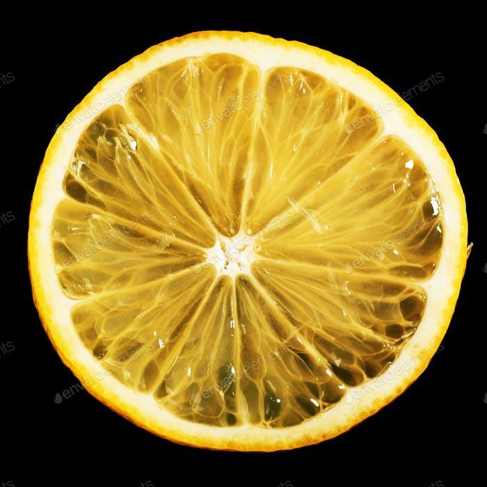 Fresh juicy slices of lemon on a black background