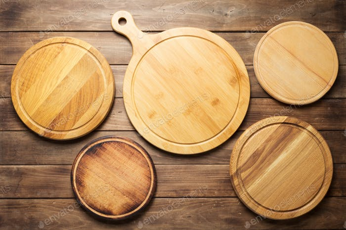 pizza cutting board at wooden plank table