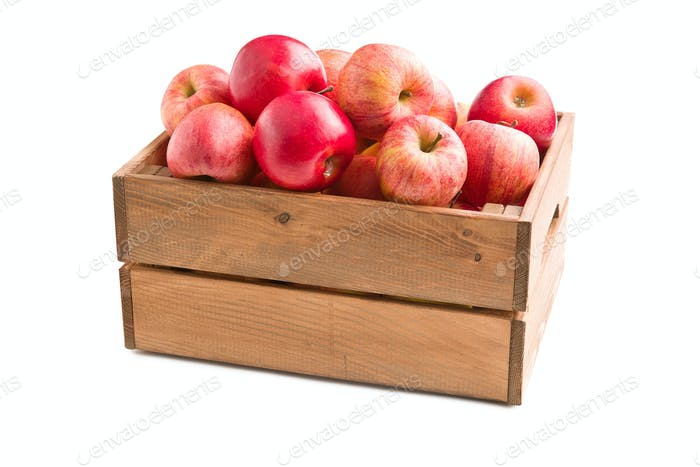 red autumn apples in wooden box