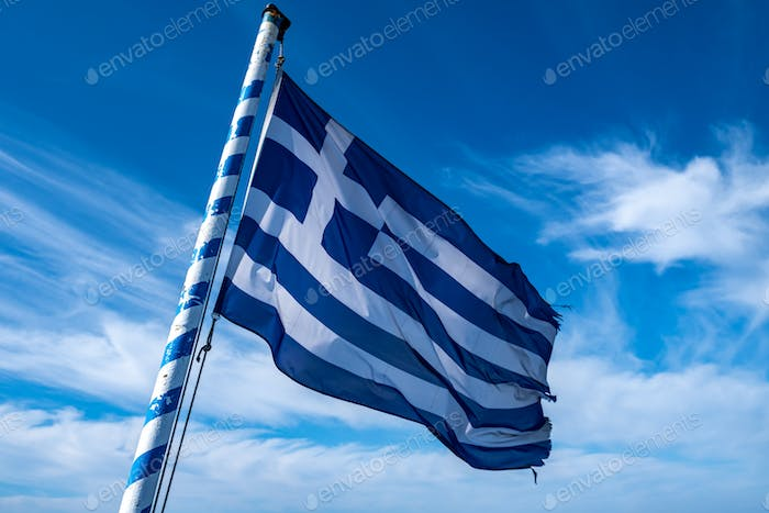 Greek flag waving against blue sky background