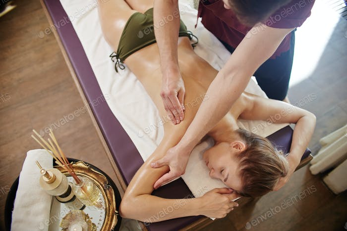 Young  Woman Enjoying Massage in SPA