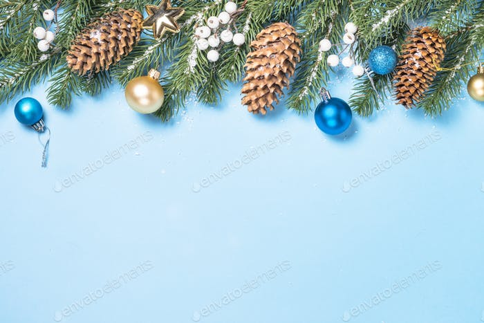 Christmas flatlay background - fir tree and decorations on blue