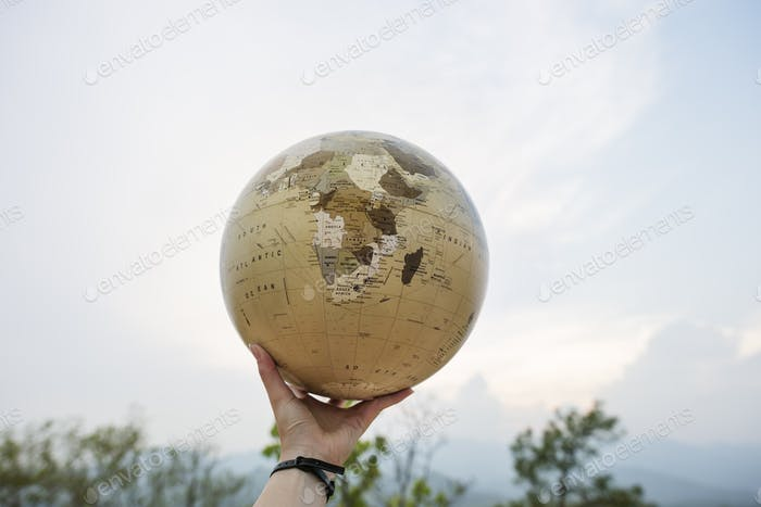 Hand Holding Globe World Location Concept