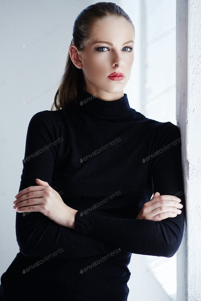 Woman with crossed arms on her chest.