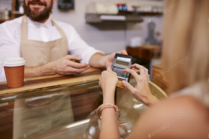 Paying for coffee by credit card reader
