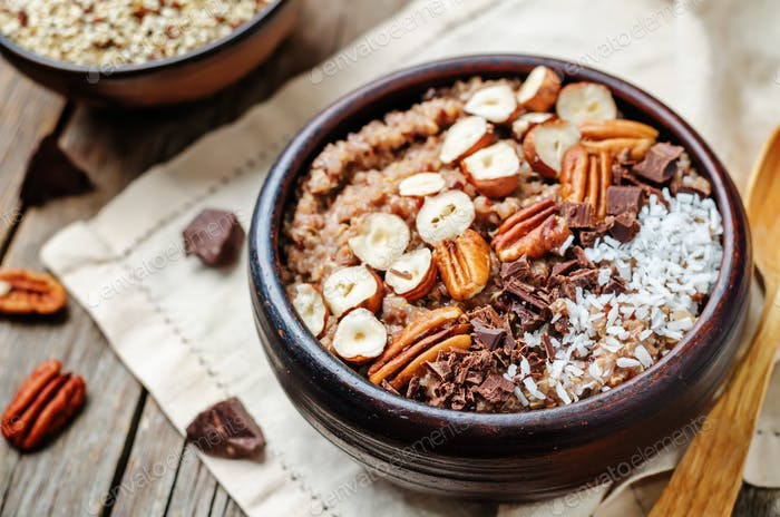 Chocolate Quinoa breakfast bowl decorated with hazelnuts, Pecan,