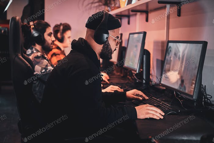 Teenagers are playing videogames at internet club