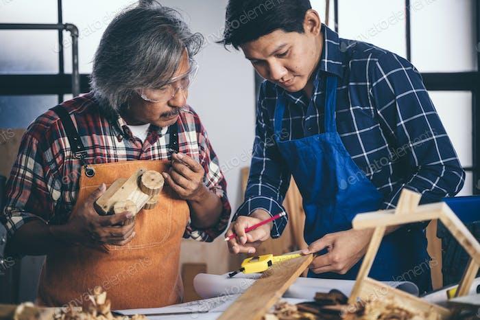 The carpenter is working in the studio, Handmade woodworking