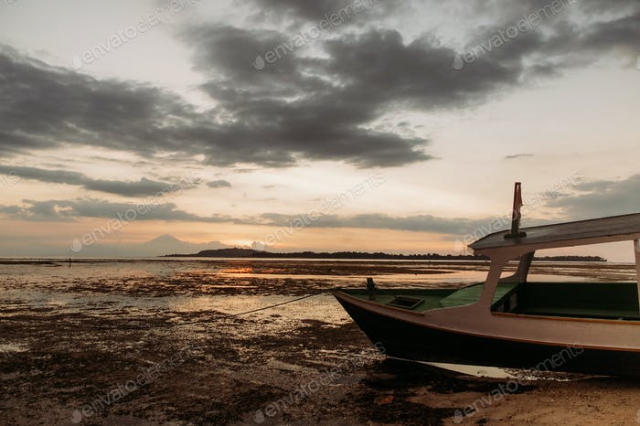 pleasure boat on low tide coastline