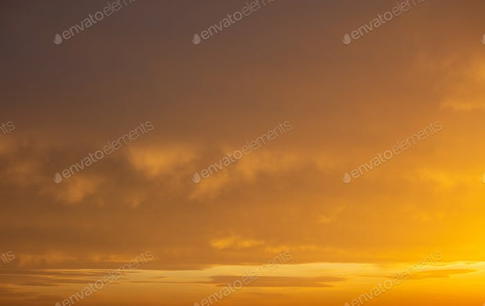Sunrise orange sky background. Twilight, dawn cloudy sky