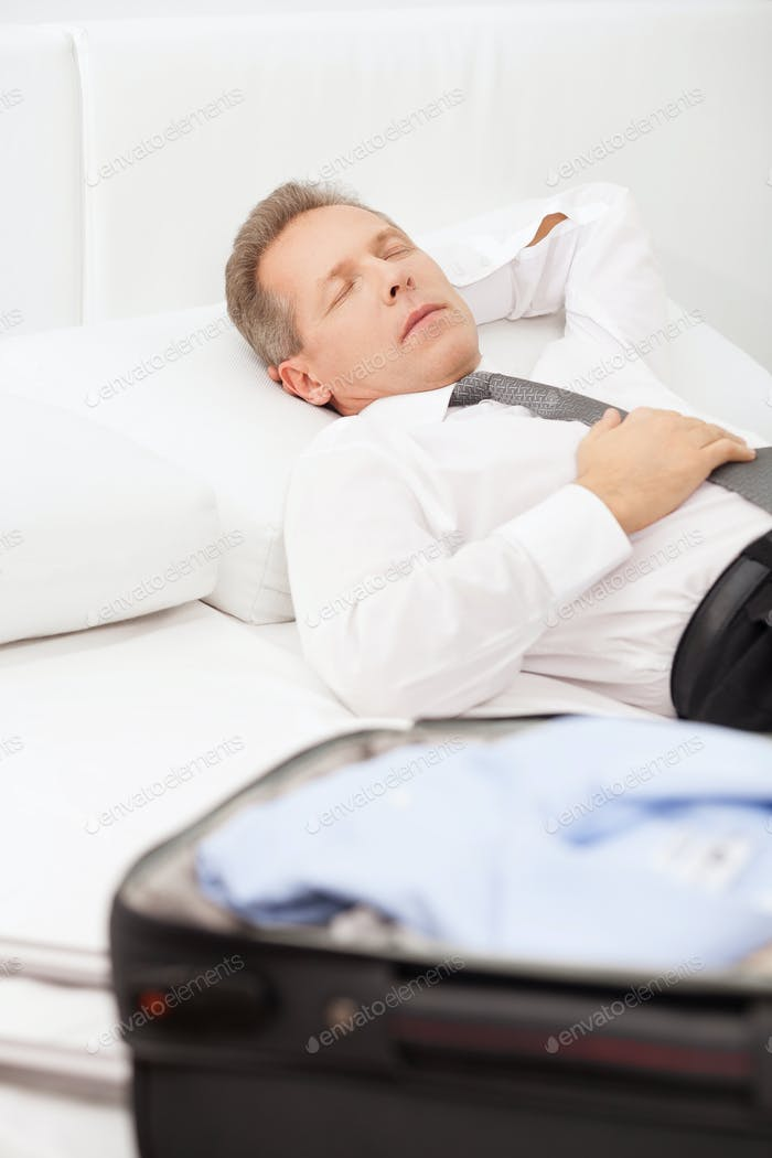 Tired businessman sleeping.
