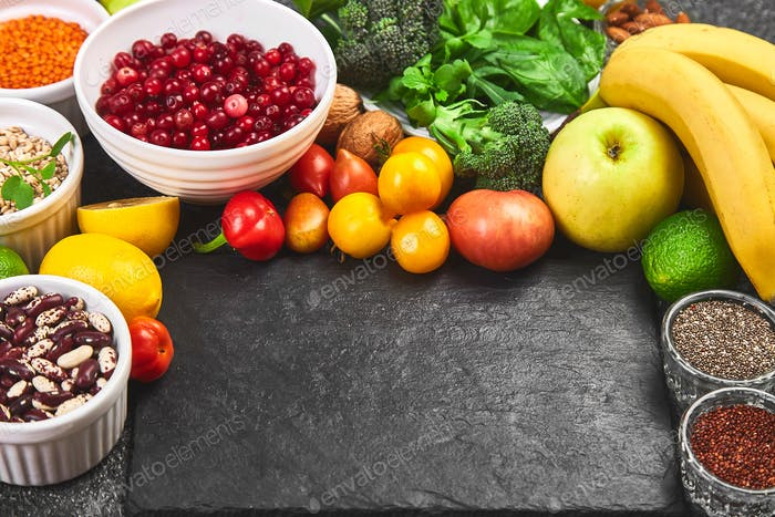 Assortment of alkaline food on dark grey background,