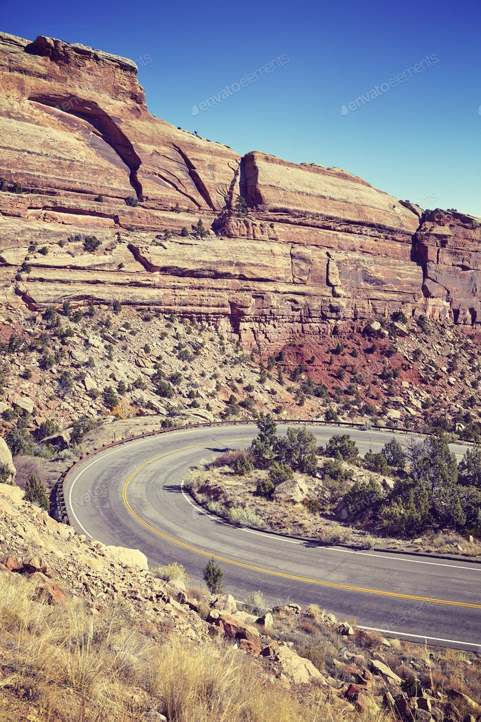 Vintage toned scenic curved road, travel concept background, Col