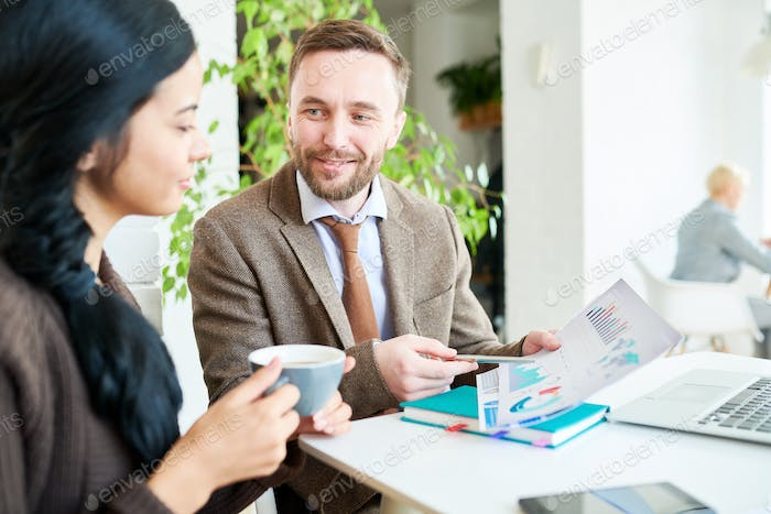 Handsome Smiling Businessman in Meeting