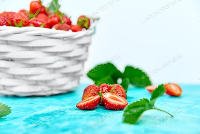 Strawberries in white basket. Fresh strawberries. Beautiful strawberries.