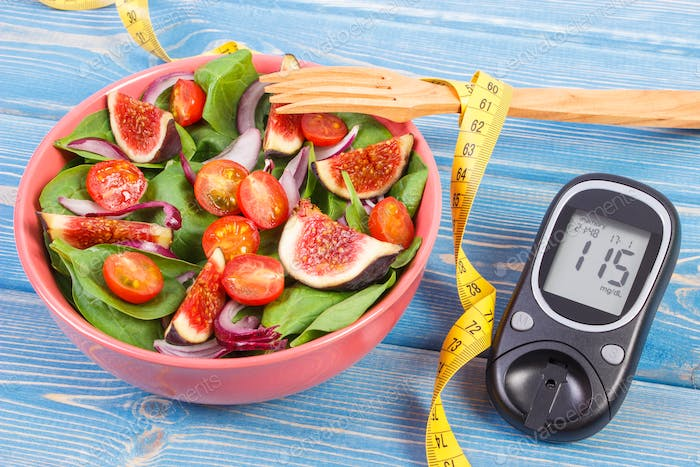 Fruit and vegetable salad and glucometer with tape measure, concept of diabetes