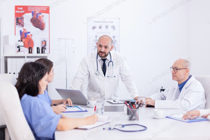 Doctor talking standing and talking
