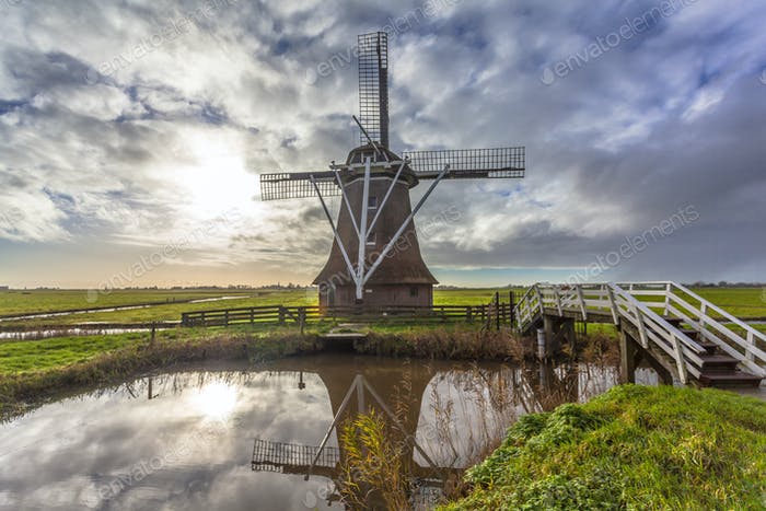 Dutch windmill along canal