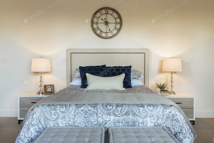 Bed and lamps in ornate bedroom
