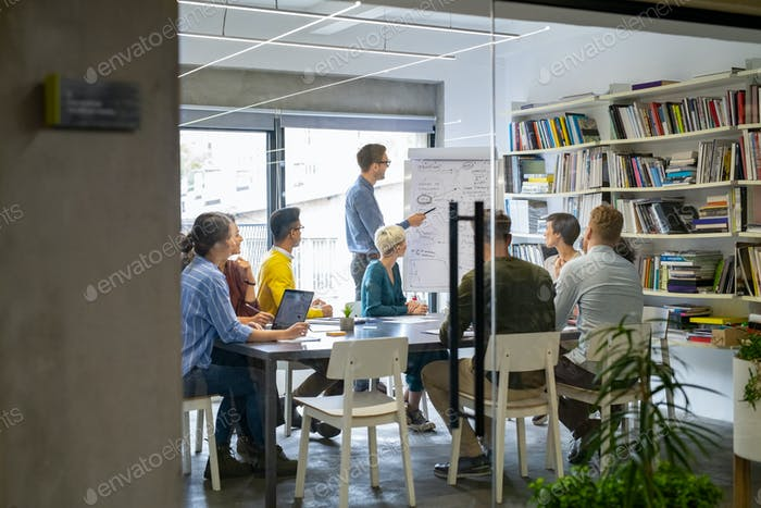 Casual business people working in meeting room