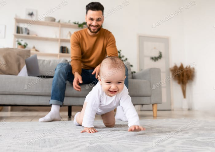 Happy Young Father Playing With Baby Toddler At Home