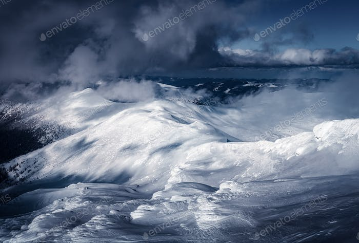 Fantastic winter landscape with snowy hills