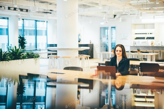 Businesswoman working in modern co-working.