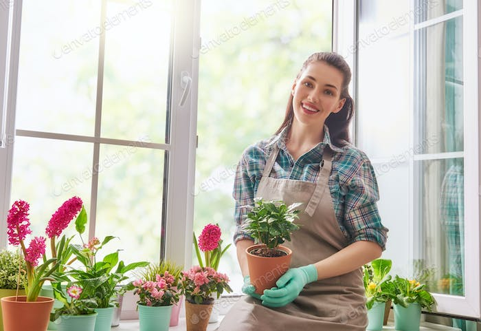 woman caring for her plants.