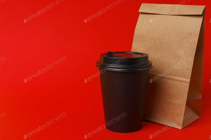 Takeaway food concept. Some packed food in container with coffee cup