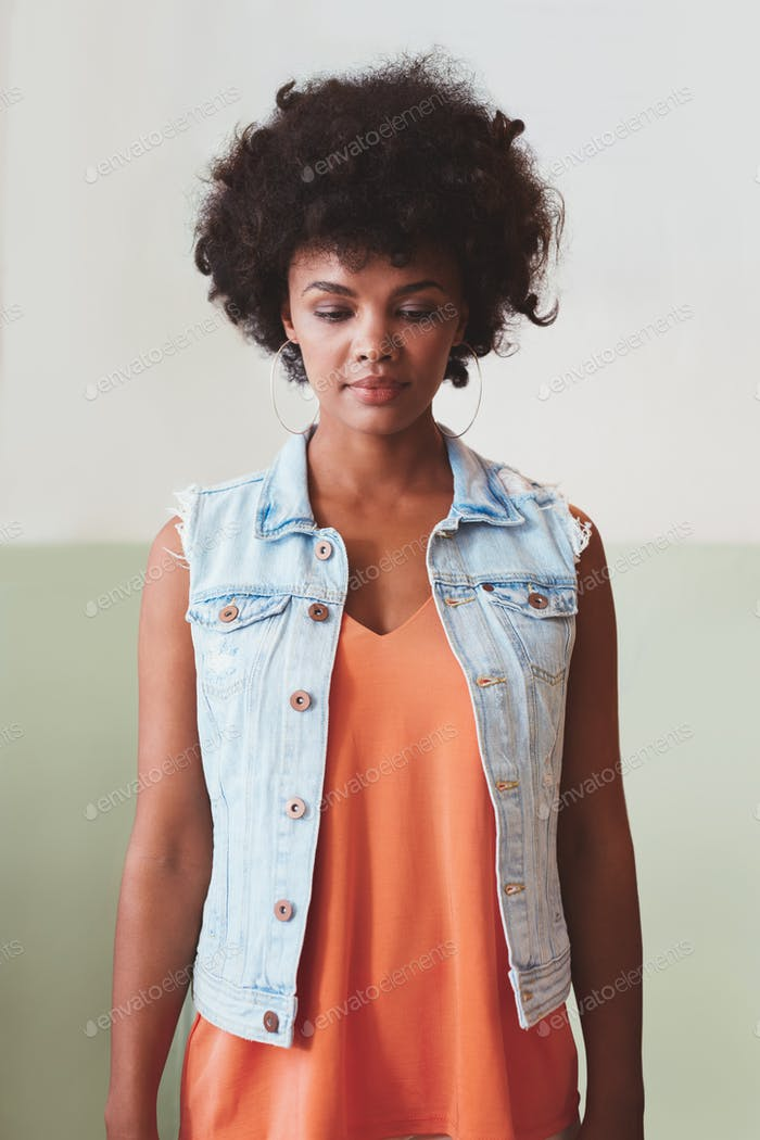 Attractive young woman standing alone
